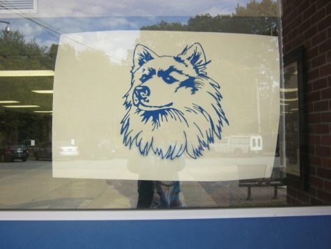 Husky at the entrance to The Morgan School