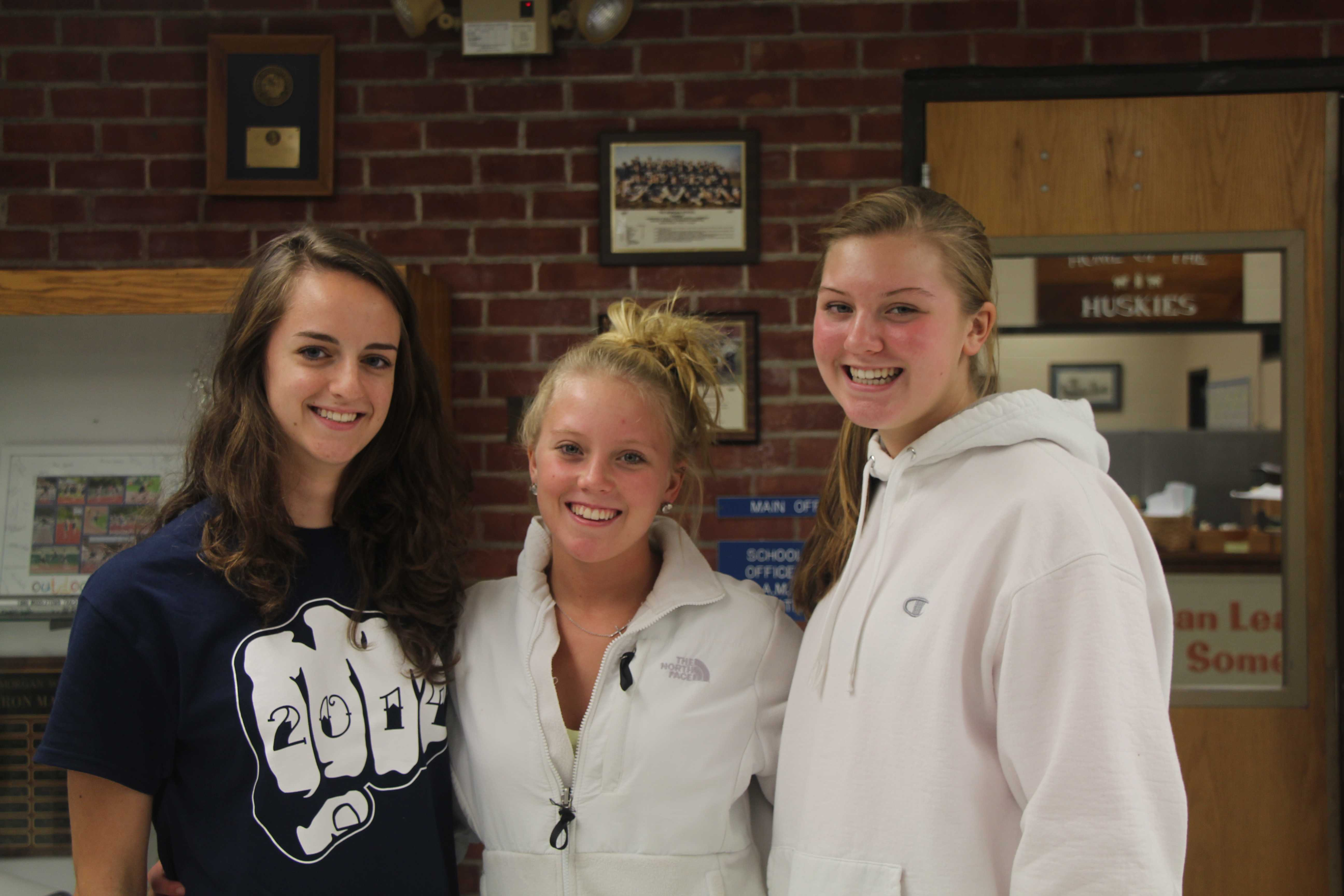 Volleyball Captians Sarah Dahlberg, Lily Dawson and Jen Dawson