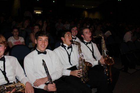 Members of the Morgan Band sitting front row. From left to right: Michael Van Ness, Ethan Paradis, Jonathon Chann, Patrick McAllister, and Jonathan Markovics