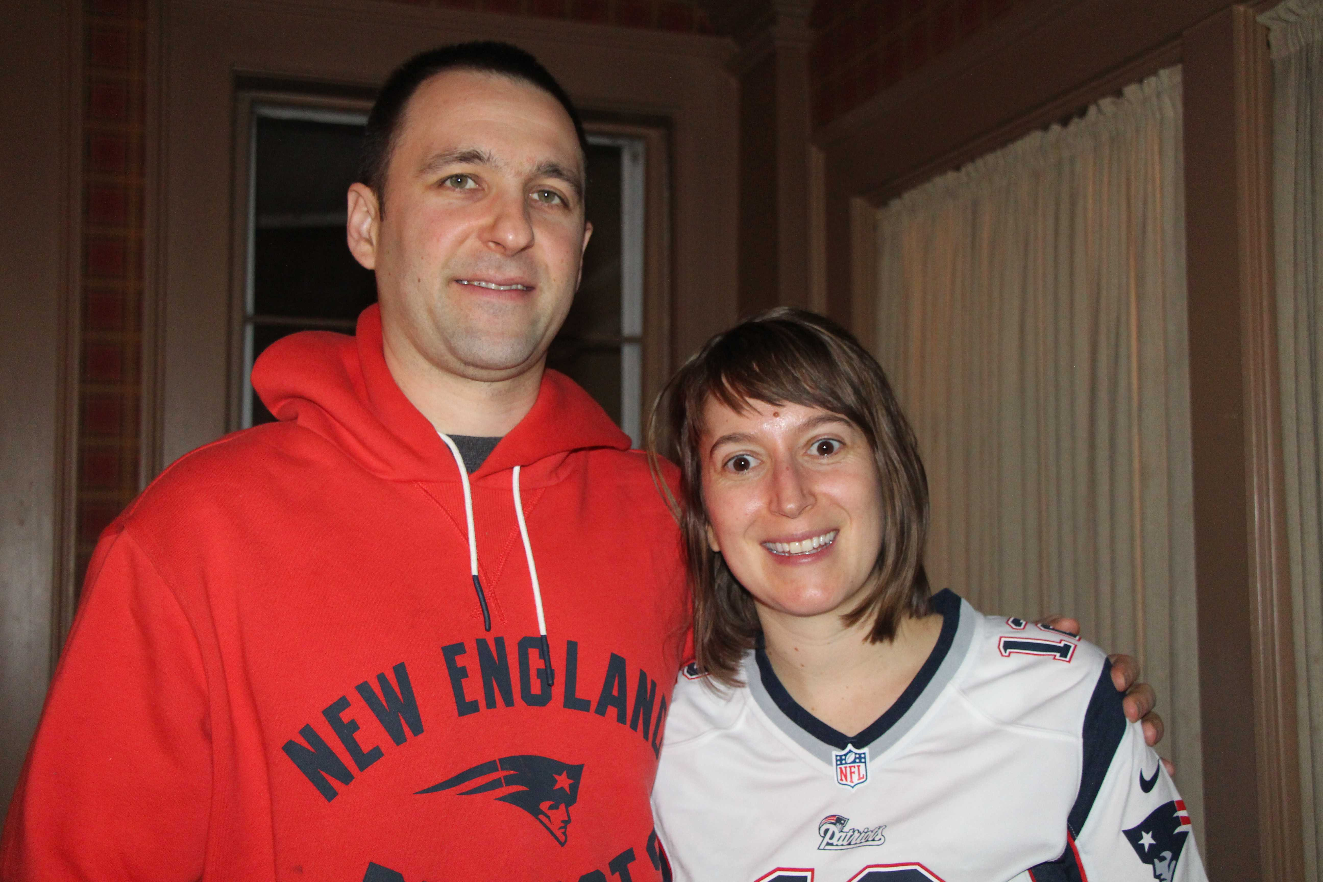 A couple enjoying the AFC Championship game at a hotel in New Hampshire