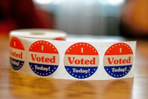 Voting stickers are displayed Sept. 8 at the Bangs Community Center in Amherst during the state primary election. SARAH CROSBY/Gazette Staff