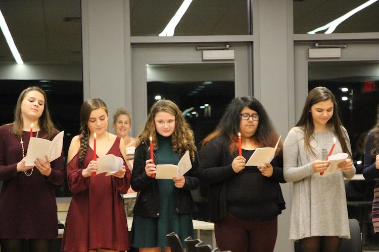 Students reading the induction pledge