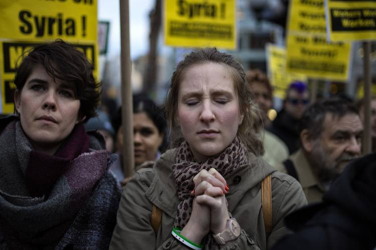 A protester reacts during a rally against the U.S. missile strikes in Syria, Friday, April 7, 2017, in New York. Hundreds of demonstrators took to New York City streets chanting