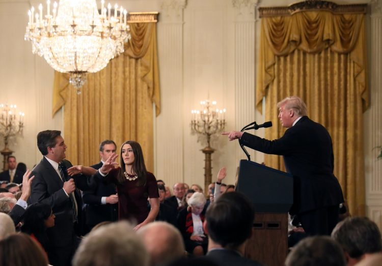 A+White+House+staff+member+reaches+for+the+microphone+held+by+CNN%27s+Jim+Acosta+as+he+questions+U.S.+President+Donald+Trump+during+a+news+conference+following+Tuesday%27s+midterm+U.S.+congressional+elections+at+the+White+House+in+Washington%2C+U.S.%2C+November+7%2C+2018.+REUTERS%2FJonathan+Ernst+++++TPX+IMAGES+OF+THE+DAY
