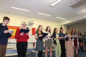 Inducting students to the French and Spanish Honor Societies