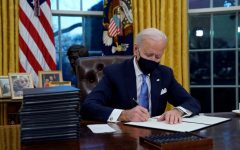 Biden signs executive orders at the start of his presidency.  Image via ABC Chicago