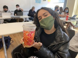 Senior, Norimar Lopez, poses with her coffee.