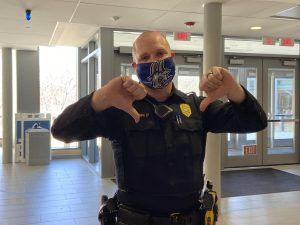 Officer Corbin giving two thumbs down to teen vaping.