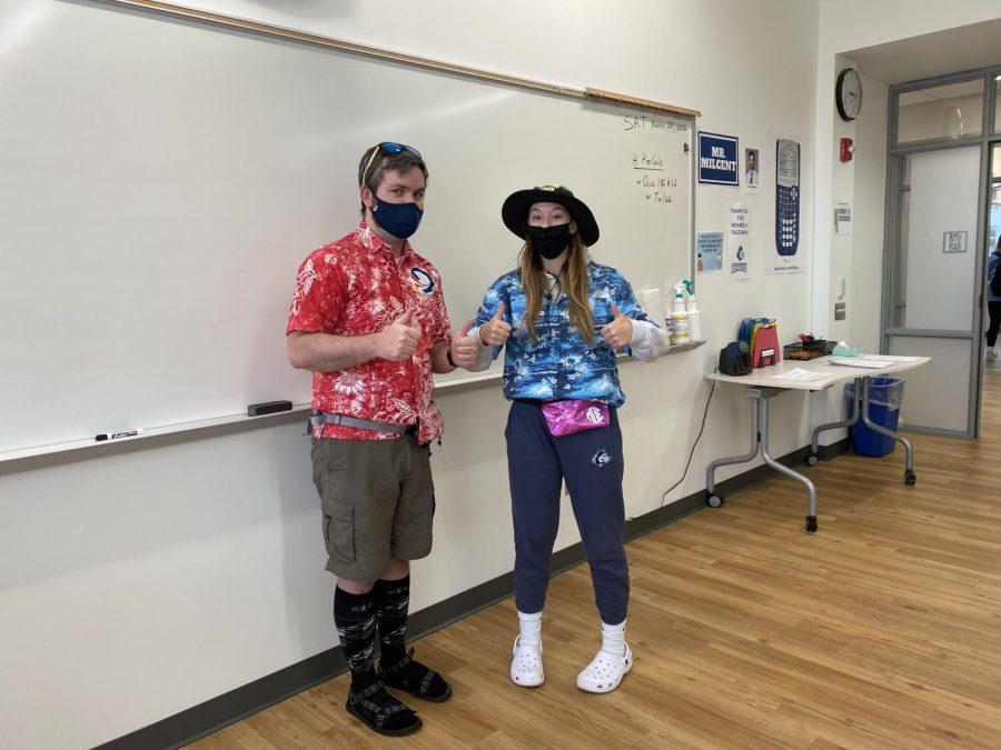 A student and teacher dress up as tacky tourists for spirit week