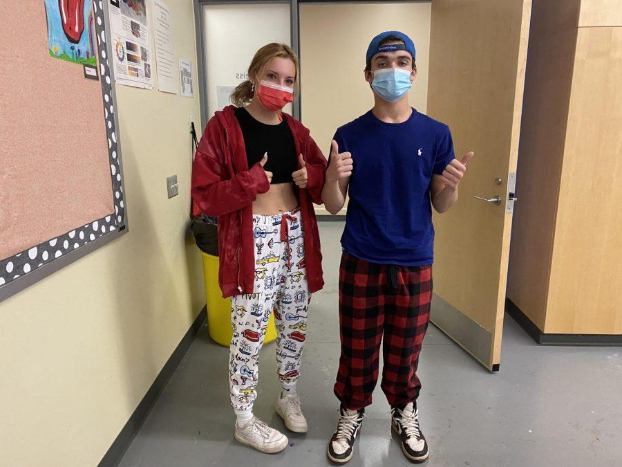 Two students wear pajamas for spirit week
