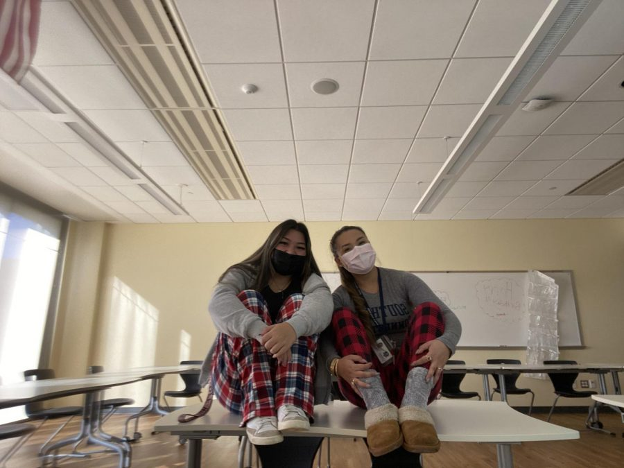 A student and teacher wear pajamas for spirit week